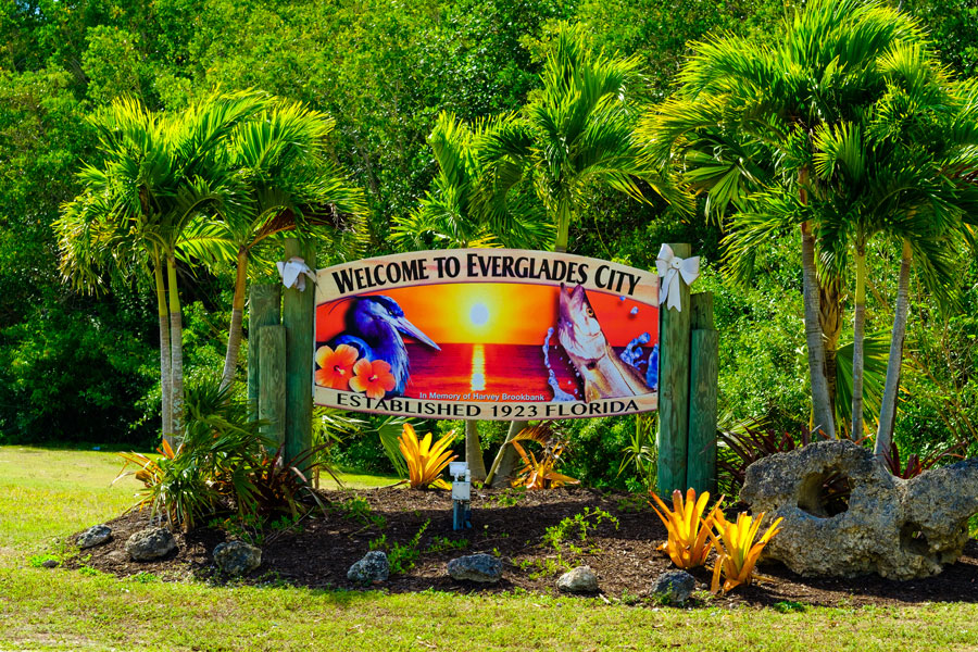 A colorful welcome sign to the small rural city located in the Florida Everglades. Everglades City, FL on January 26, 2017. Photo credit: Fotoluminate LLC, Shutterstock.com, licensed.