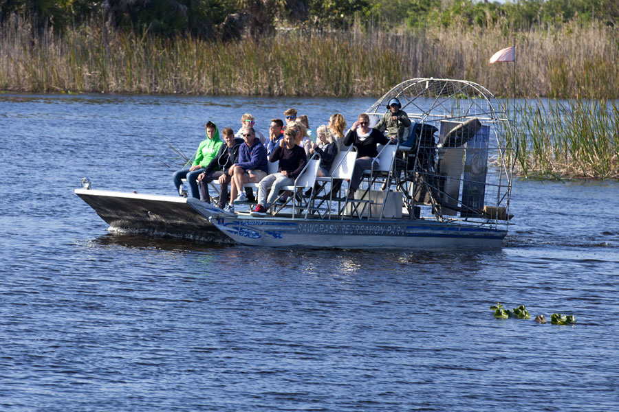 Tourists enjoying an airboat ecotour of the Sawgrass Recreation Park in the National Everglades Park near Weston, Florida on February 13, 2016.