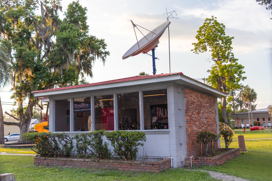 A talk radio station occupies a tiny building on the edge of a public park in the center of town along U.S. Route 41. Jasper