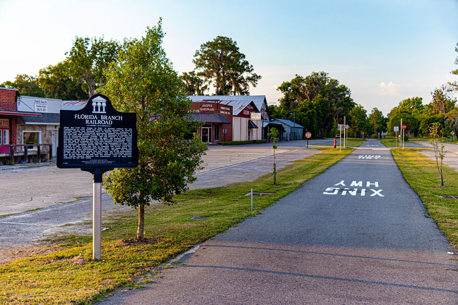 A sign marks the site and history of the former Florida Branch Railroad on which this walking and cycling trail is built. Jasper, Florida,