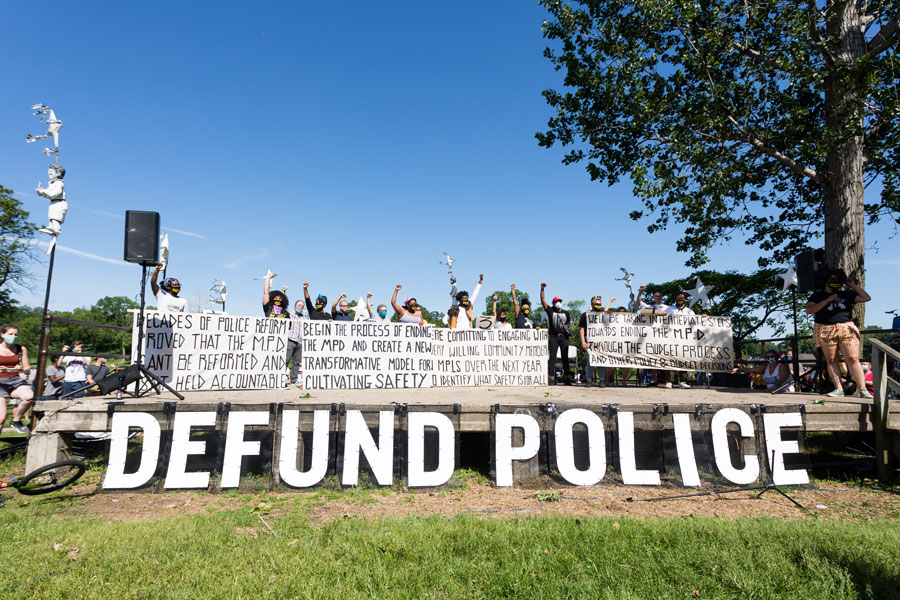 Members of the Black Visions Collective and Reclaim the Block hold banners outlining the City Council's plan to dismantle the police department. Minneapolis, MN, June 7, 2020.