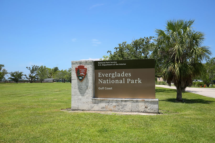 Everglades National Park Gulf Coast entrance sign at the entrance to the park, as seen on July 27, 2019. Everglades City, Florida.