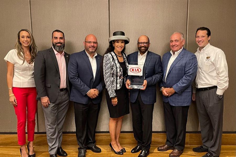 Raquel Case, Daniel Valdes (Kia), Jimy Contreras (Rick Case Kia GM), Rita Case, President and CEO, Rick Case Automotive Group, Percy Vaughn (Kia), Leroy Larson (Rick Case Executive GM), Ryan Case.