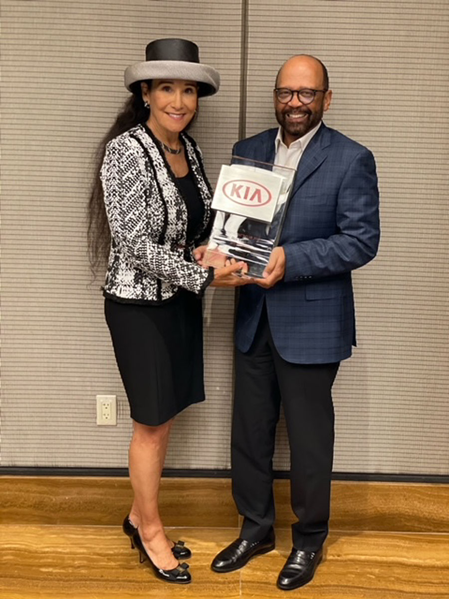 Rita Case, President and CEO of Rick Case Automotive Group with Percy Vaughn, Executive Director, Regional Operations of Kia Motors America.