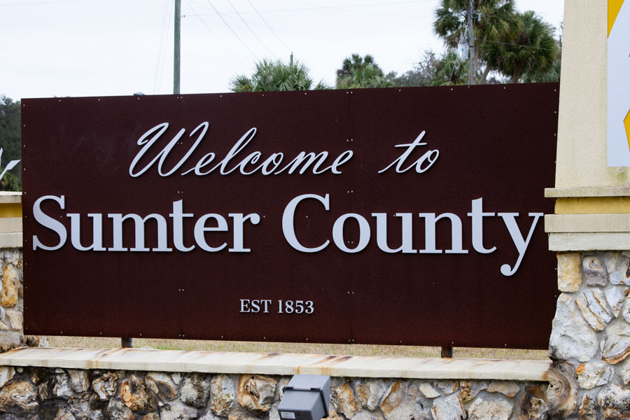 Welcome to Sumter County sign in Inverness, Florida on December 27, 2020. Editorial credit: Paulo Almeida Photography / Shutterstock.com, licensed.