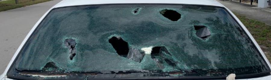 Actual damaged back window of marked PBSO patrol car
