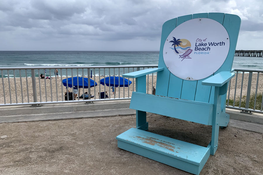 I love this chair that was built and placed on the boardwalk at our Lake Worth beach and this tourist loved it too!