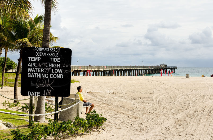 Fishing pier and weather information board photographed on January 8, 2016 in Pompano beach, Florida