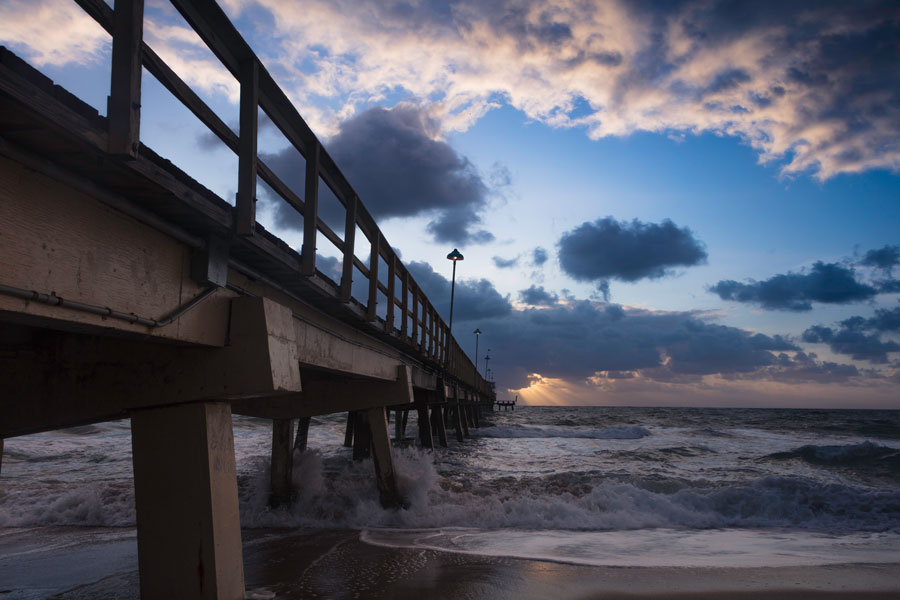 Pompano Beach Pier in Broward County Florida at the Beach at sunrise.