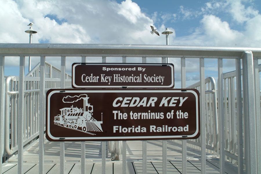 Sign for Cedar Key Pier on the Gulf Coast of Florida. Photo credit ShutterStock.com, licensed.