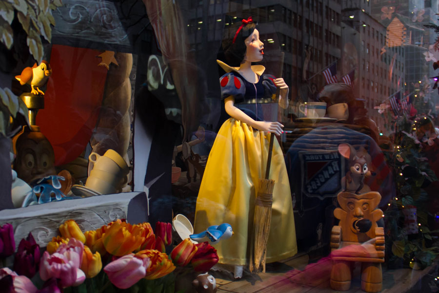 Snow white with a broom in Saks Fifth Avenue's holiday window display; In celebration of the 80th anniversary of Disney's Snow White and the Seven Dwarfs. Manhattan, New York, December 20, 2017 Editorial credit: Spinel / Shutterstock.com, licensed.
