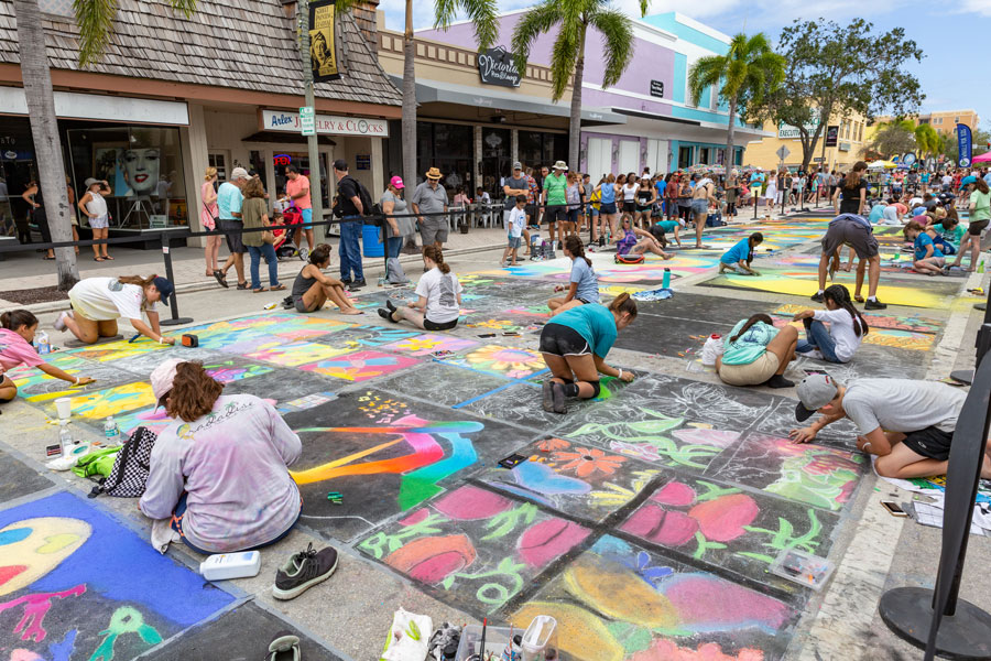 The Annual Street Painting Festival; artist everywhere as far as the eye can see all working hard on painting art on the streets of the small beach town. Lake Worth, Florida, February, 24, 2019. Editorial credit: Manny DaCunha / Shutterstock.com, licensed.