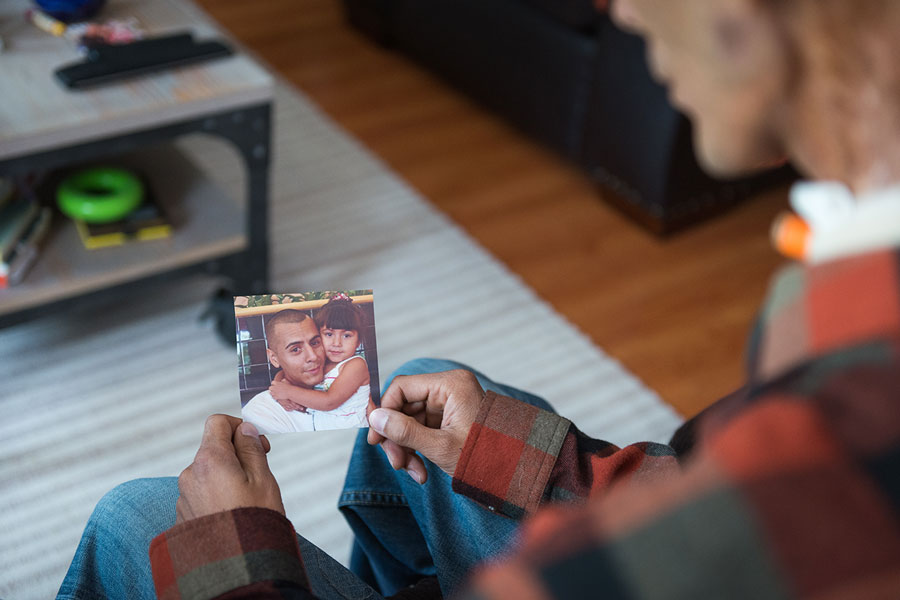 Brian looks at a photograph of himself and Rhianna when she was 3. He'd already been diagnosed with cancer and had started chemotherapy.