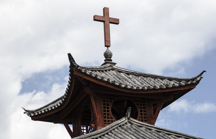 A Christian cross on top of a Chinese Christian church.