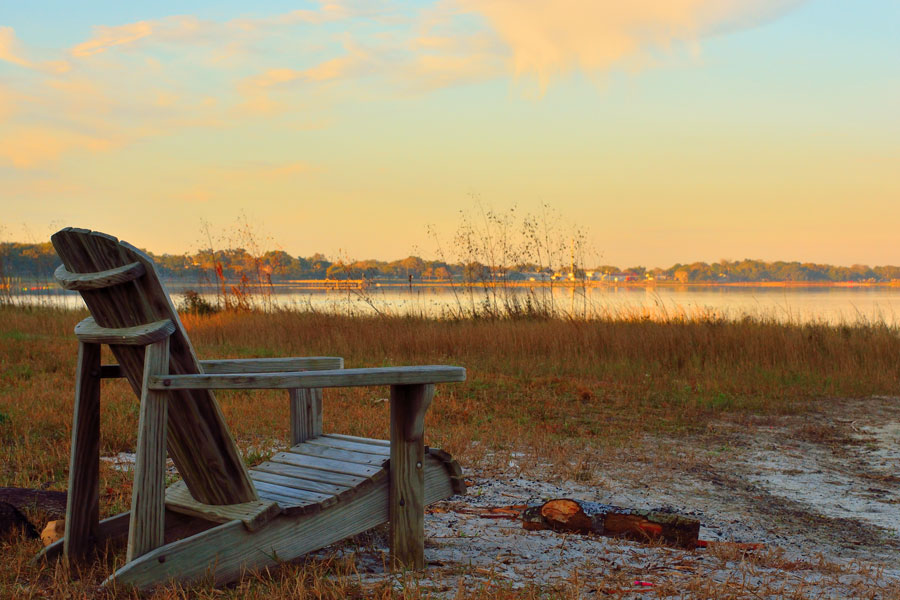 An Adirondack Chair Looking out to Lake Minneola, Clermont, Florida. Photo credit ShutterStock.com, licensed.