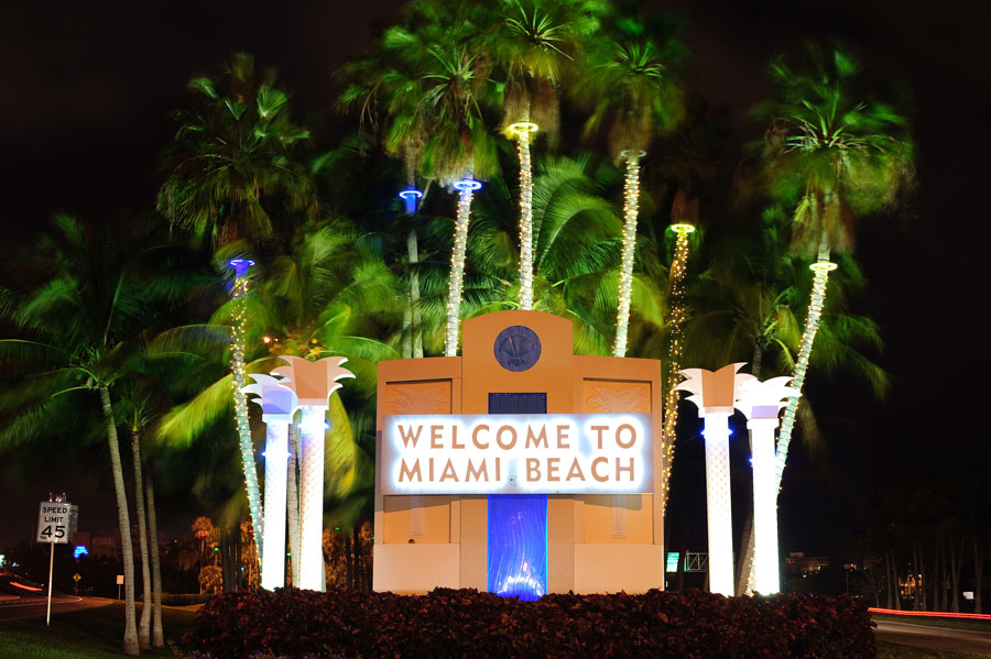 Welcome sign entering in Miami beach at night. Photo credit ShutterStock.com, licensed.