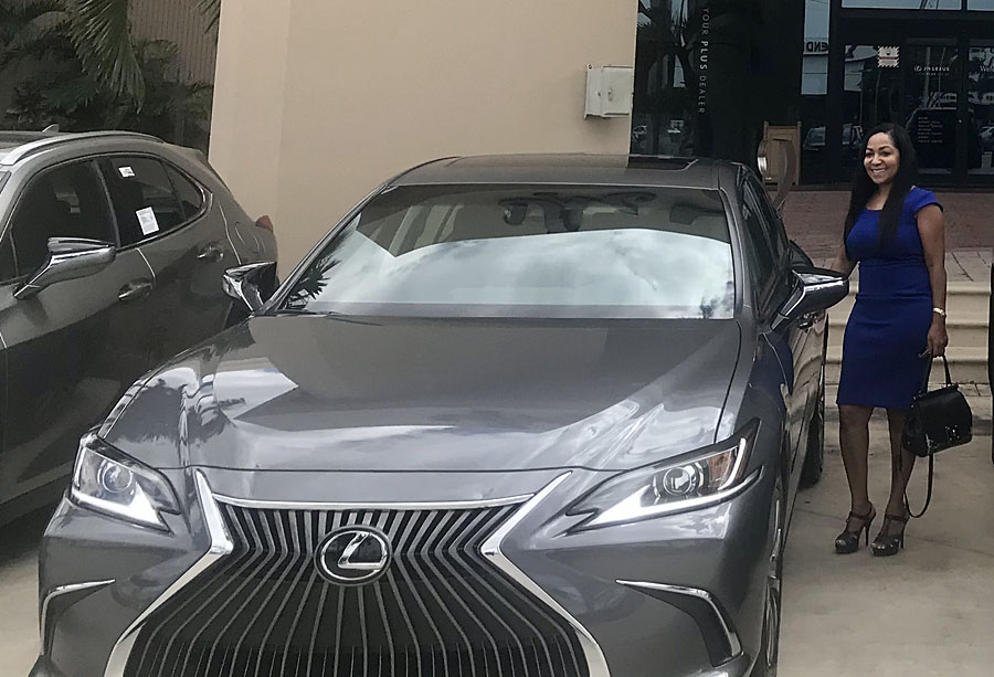 Fort Lauderdale local Michelle Smith, winner of the annual car giveaway, with the new 2021 Lexus ES 350.