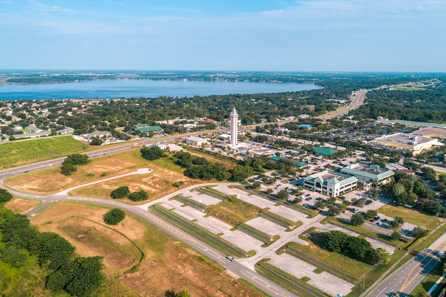 A serene day in the peaceful city of Clermont. A birds eye view of the historic Citrus Tower with Lake Minneola of the Chain of Lakes in the background. Just south of Minneola. Lake County, August 27th 2018. Photo credit: Noah Densmore, Shutterstock.com, licensed.