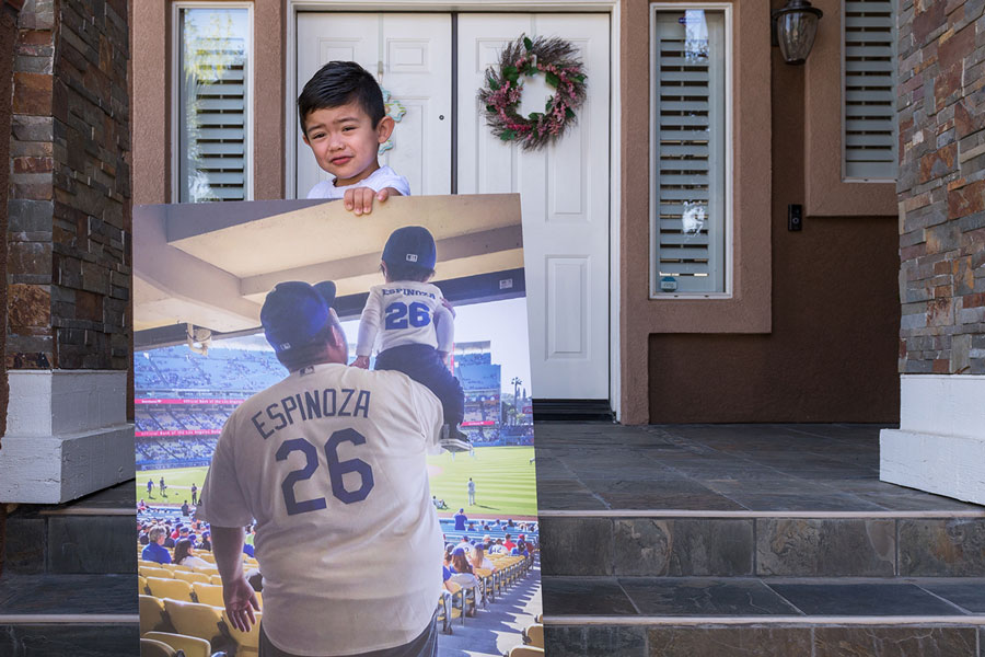 Ezekiel Espinoza holds a photograph of his first Los Angeles Dodgers game with his dad, Antonio.