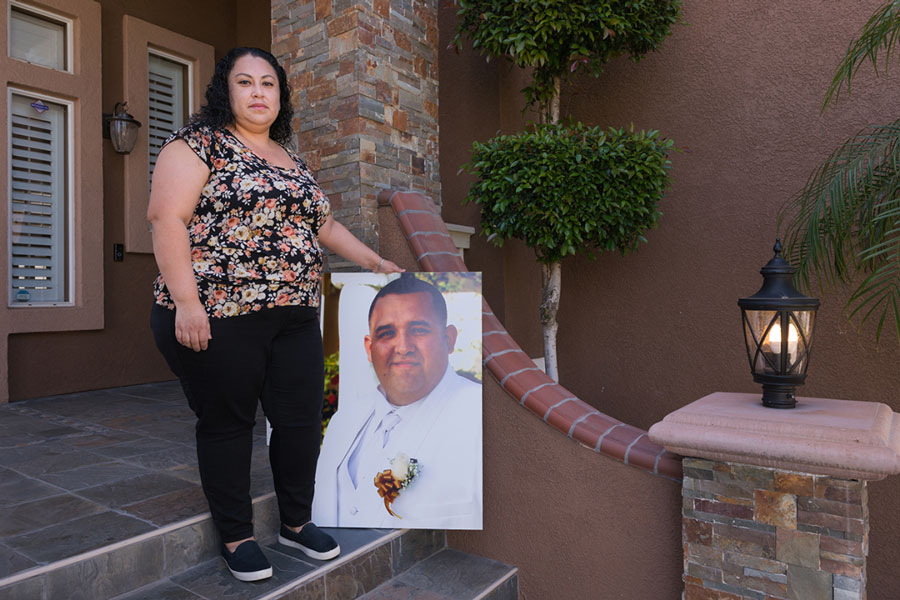 Nancy Espinoza holds a photograph of her husband, Antonio, that had been displayed at his memorial service in March. He died of covid-related complications on Jan. 25, 2021.