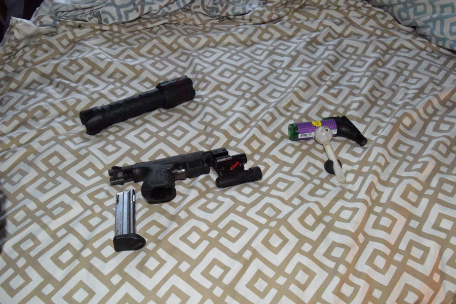 While inside, members located a loaded handgun, various rounds of ammunition, Methamphetamine, multiple store bought and homemade pipes, syringes, and a scale in various locations throughout the home.