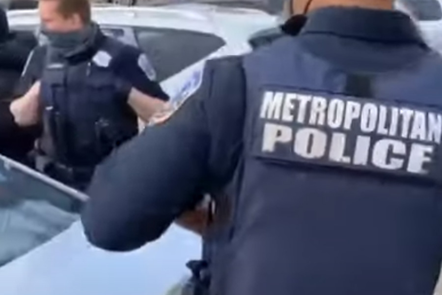 A video captured a confrontation between an unknown man and officers of the Metropolitan Police Department in Washington, DC over the death of 16-year-old Ma'Khia Bryant in Ohio last week.