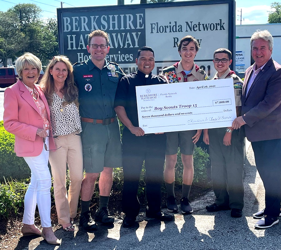 The Beaches office in Atlantic Beach presented $7,000 to Boy Scout Troop 15. From left, Founder and Chairman Linda Sherrer, Realtor Jennifer Sexton, Troop Leader Brian Sexton, Father Rafael Lavilla (St. John the Baptist Catholic Church), Will Walker, Donovan Rodriguez and Broker/Manager Don Cline.