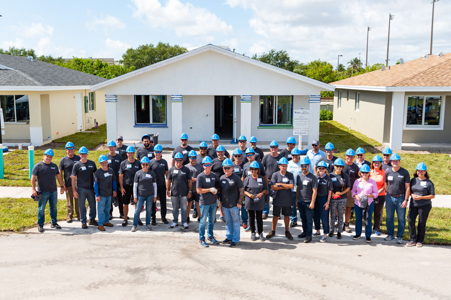 South Florida CEOs in front of new Habitat homes they landscaped during Habitat Broward's 2nd annual CEO Build.