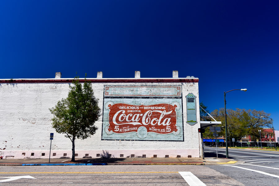 A mural in this quaint town on Florida's panhandle commemorates its Coca Cola millionaires, descendants of 67 early purchasers of stock on the beverage giant. Quincy, Florida,