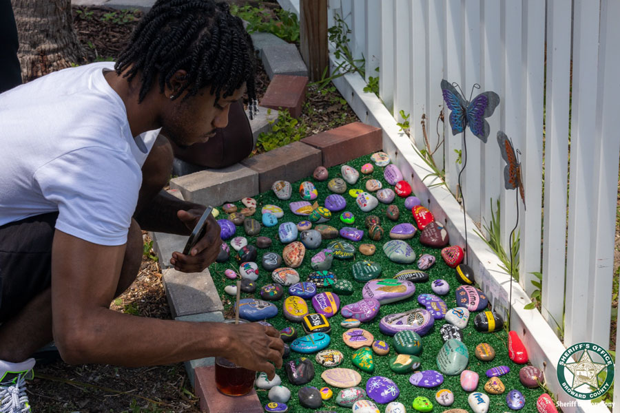 The garden is located at Lola's Market in Wilton Manors and joins a mural dedicated to Broward Sheriff's Office Deputy Shannon Bennett and a garden of painted rocks that honors the seven Broward Sheriff's Office employees who died from COVID-19.