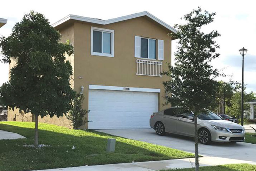 A two-story Habitat home in Pompano Beach. The new energy efficient models will include garages, landscaped yards, four bedrooms, hurricane windows, and modern kitchens.