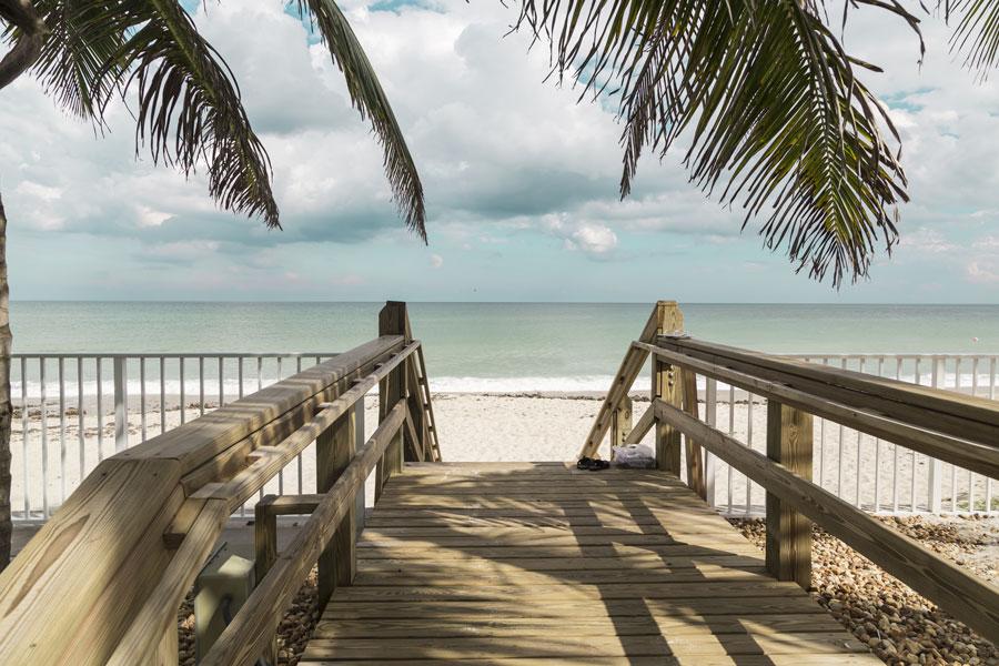 Wooden stairs on deserted beach dunes in Vero Beach, Florida. Photo credit ShutterStock.com, licensed.
