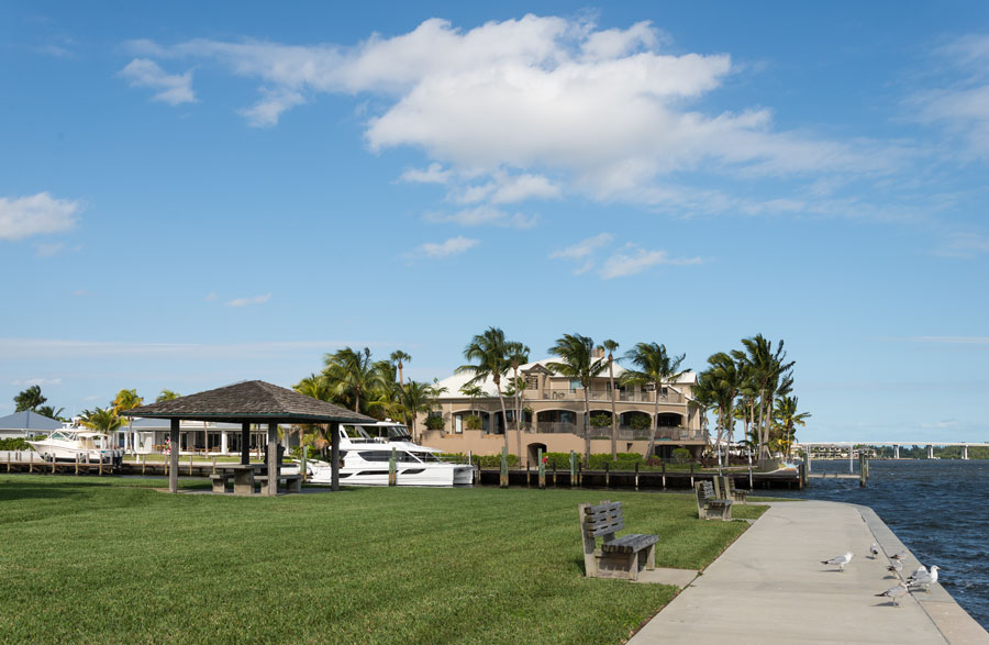 Waterfront homes and boats in Vero Beach, Florida. Photo credit ShutterStock.com, licensed.