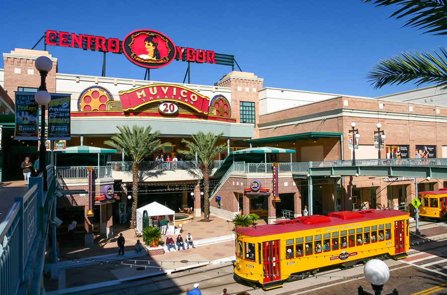 Centro Ybor entrance with yellow trams and visiting tourists, Tampa, FL. November 29, 2003. File photo: Pixachi, Shutterstock.com, licensed.