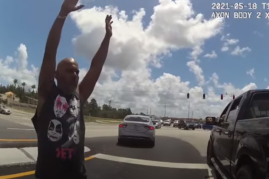 Upon pulling over, the motorist, Frank Padilla Velez, 41, began behaving erratically, jumping out of his truck and lying down in the roadway.