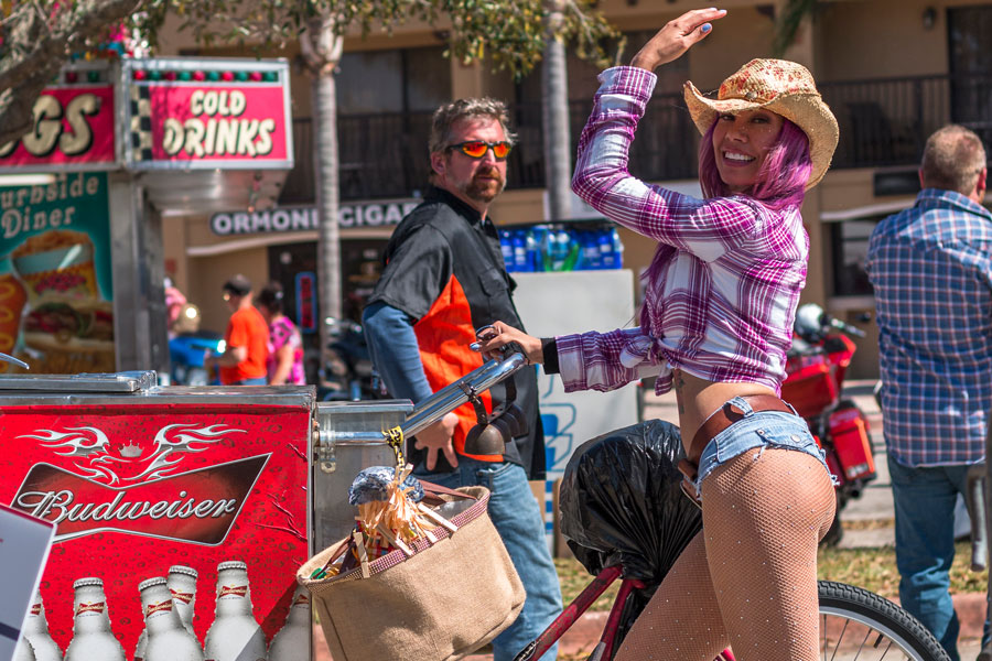 A bartender by bicycle during Bike Week event at Destination Daytona in Ormond Beach Florida. March 13, 2018. File photo: Edie Ann, Shutterstock.com, licensed.