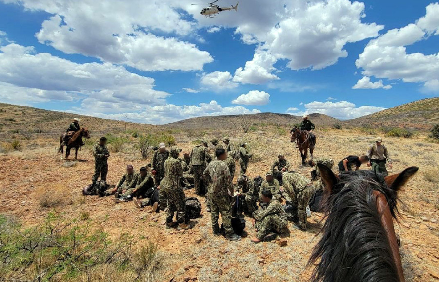 Interim Chief Patrol Agent for the Tucson Sector, John Modlin, announced the incident via Twitter, and included a picture of the mounted officers detaining the migrants while a helicopter was seen in the overhead sky.