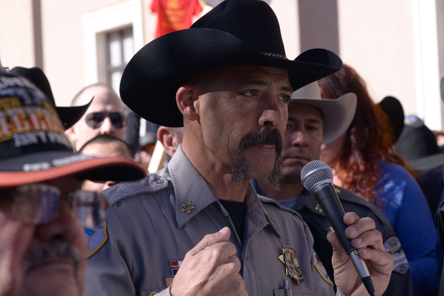 Cibola County Sheriff Tony Mace addresses hundreds of Second Amendment supporters during a pro-gun rally outside the New Mexico state Capital in Santa Fe. Santa Fe, New Mexico on January 31, 2020. File photo: Chuck Jines, Shutterstock.com, licensed.