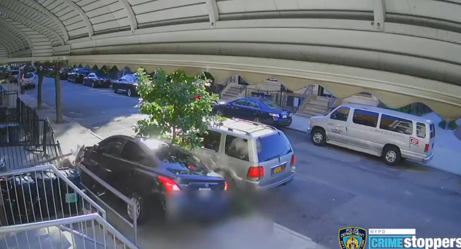 The surveillance video then shows the victim speeding around parked cars and onto the sidewalk at a high rate of speed, only to crash into a tree and an iron fence. NYPD Crime Stoppers