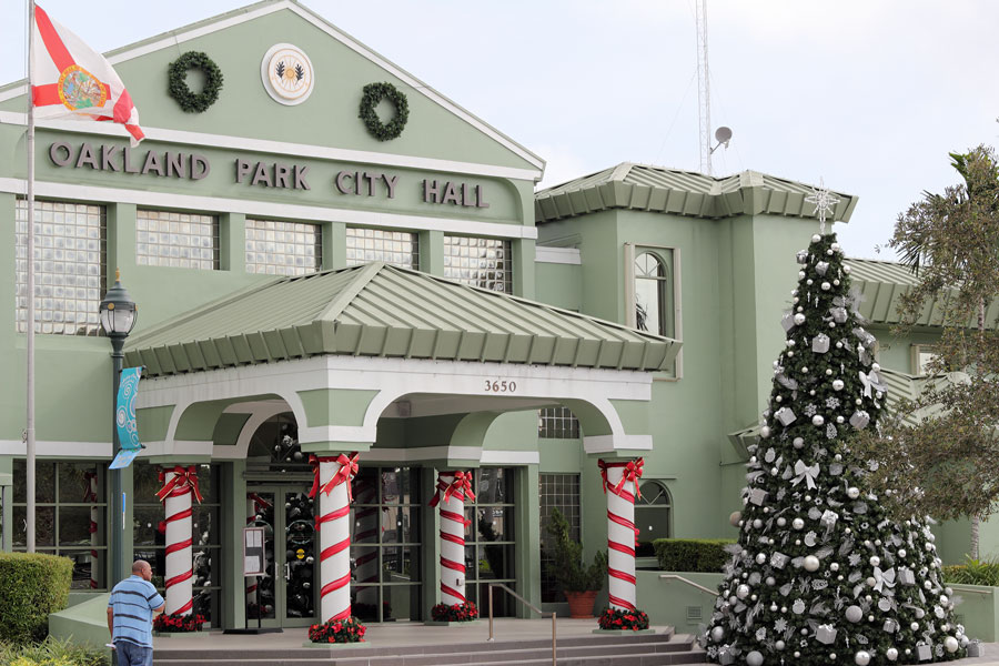 The Oakland Park City Town Hall building decorated for the winter holiday season.