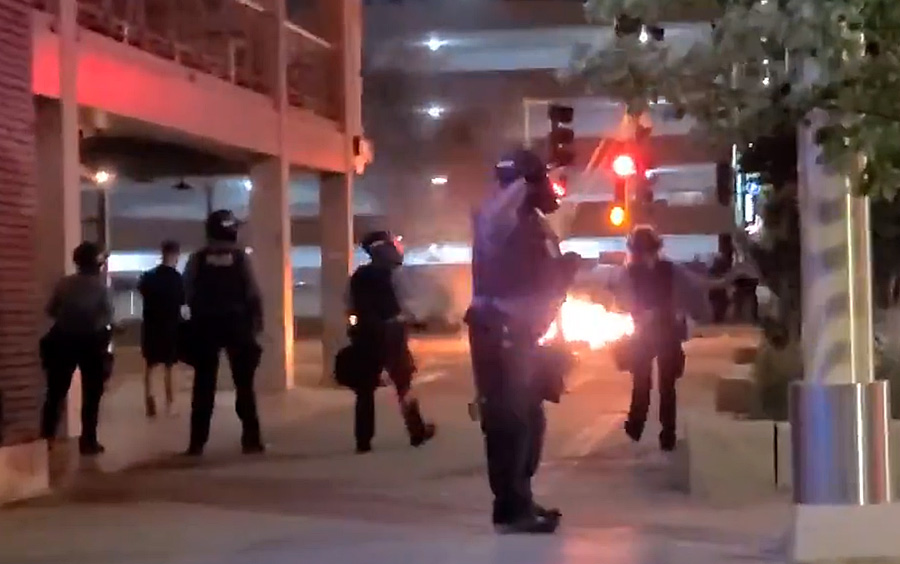 Rioters responded to the shooting by lighting a dumpster on fire near the parking garage where the shooting took place; by the time the fire department and authorities responded and extinguished the blaze, the dumpster had practically melted, local media reported.