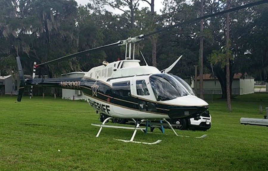 "HCSO Aviation Unit ""Air-1,"" flown by Deputy Pilot Roy McLaughlin and Tactical Flight Officer B.J. Hart."