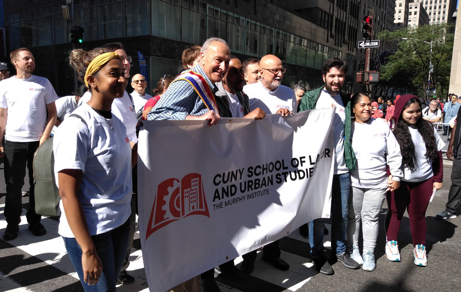 Senator Chuck Schumer poses with the CUNY School of Labor and Urban Studies, The Murphy Institute, during the 2019 NYC-CLC Labor Day Parade. New York City, New York, September 7 2019. File photo: Erin Alexis Randolph, Shutterstock.com, licensed.
