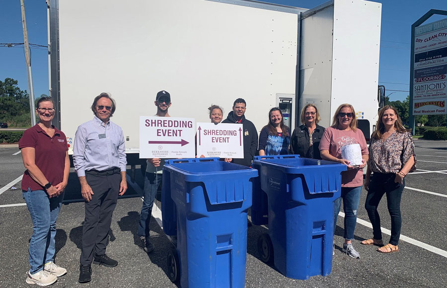 The food items and monetary donations were collected during community shredding events at the company's branch offices in Fleming Island, Mandarin and MuraBella at World Golf Village.