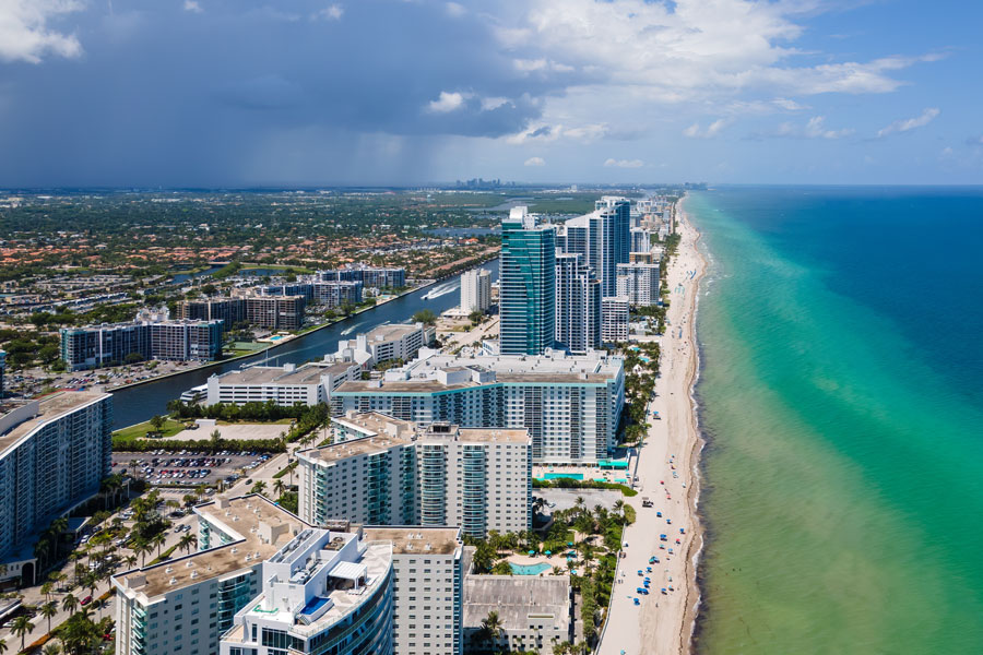 An aerial view of Hallandale Beach with a top view of skyscrapers and buildings on August 15, 2020. File photo credit: YES Market Media, Shutterstock.com, licensed.