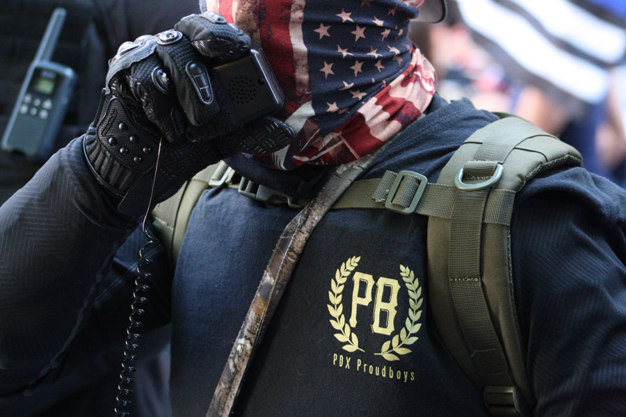 """Conservative people from the far right movement, Proud Boys, and Boogaloo join for a """"Back the Blue"""" rally wearing the American flag. File photo: Robert P. Alvarez, Shutterstock.com, licensed."""