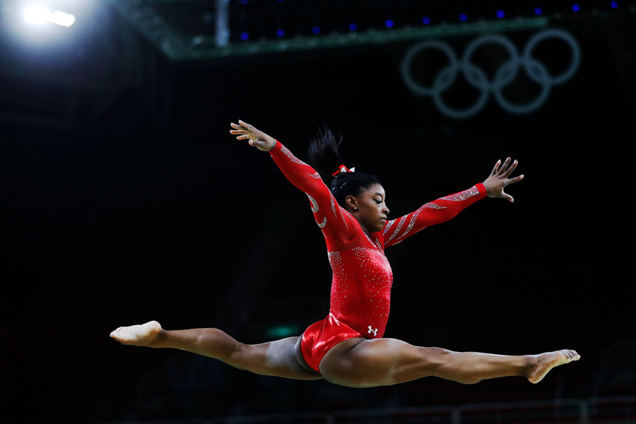 Simone Biles at the Rio 2016 Summer Olympic Games artistic gymnastics. Athlete of team USA performs a training session prior to the medal competition. File photo: Salty View, Shutterstock.com, licensed.