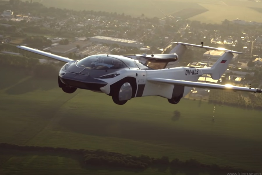 The AirCar Prototype 1 is a two-passenger vehicle that runs on a 160 horsepower BMW engine. It comes with four wheels, a pusher propeller, switchblade-style retractable wings and a telescoping tail, and can transform from airplane mode to road-legal vehicle mode in only three minutes.