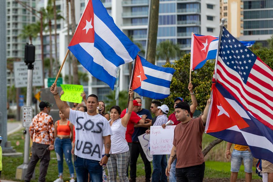Dozens of people supporting, show solidarity the growing anti governmental protest in Cuba clogged Downtown in Sarasota. Support Cuba peaceful protest. Sarasota, Florida,  July 14, 2021. File photo: YES Market Media, Shutterstock.com, licensed.