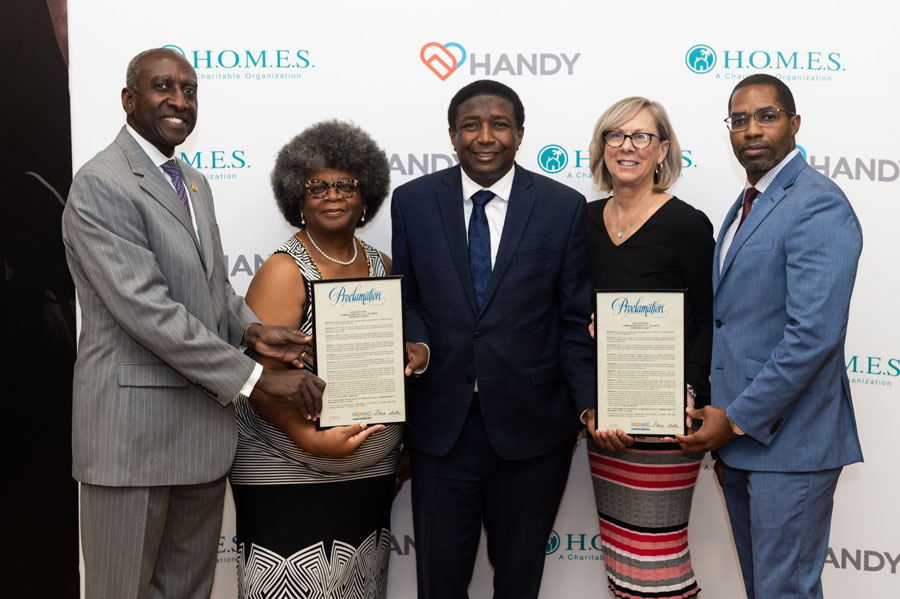 Dan Young, HANDY Board Chair; Linda Taylor, H.O.M.E.S. Inc. CEO; Broward County Commissioner Dale Holness, Pat Bessemer, H.O.M.E.S. Inc. Board Chair; and Kirk Brown, HANDY CEO. Photo Courtesy of Downtown Photo.